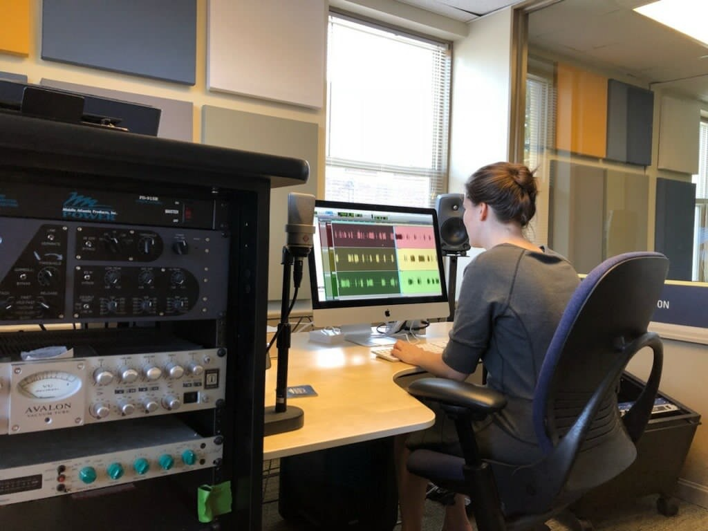 <p><em>Producer, Brigid Coyne, hard at work editing a new podcast in the newly-renovated recording studios!</em></p>